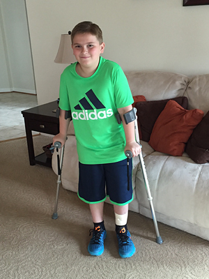 Matt at age 11 with crutches after lengthening was completed