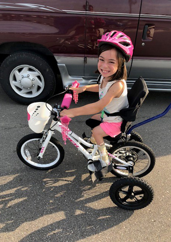 Alena riding her adaptive bike