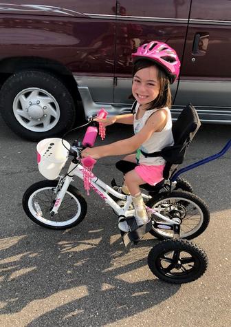 Alena riding her adaptive bike