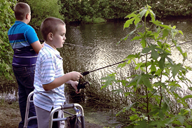 Wyatt fishing at a lake while using a walker