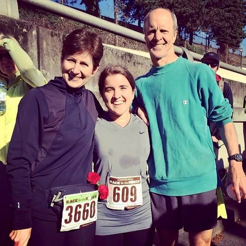Hannah with her parents after completing a half marathon in less than 2 hours in 2014--exactly 10 years after her first surgery in 2004.