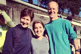 Hannah with her parents after completing a half marathon in less than 2 hours in 2014–exactly 10 years after her first surgery in 2004.