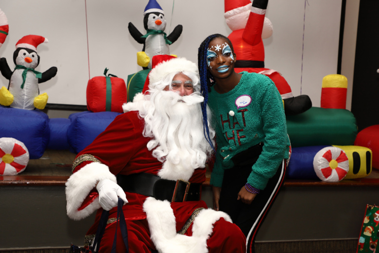 Young woman with face paint smiling with Santa