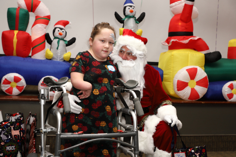 Young girl with a walker with Santa
