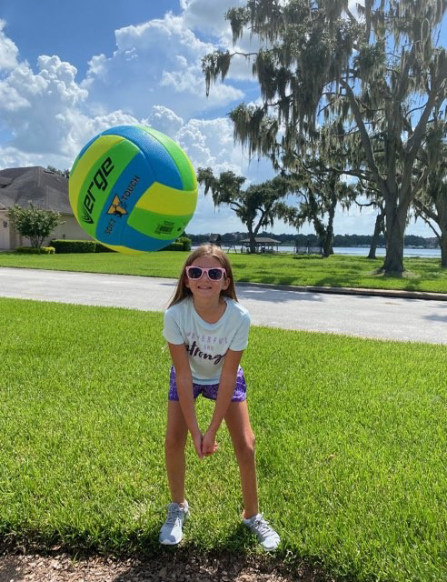 Emma playing volleyball outside