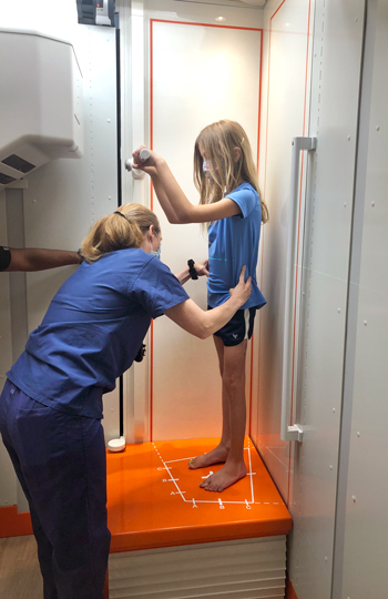 A girl standing in an EOSedge machine