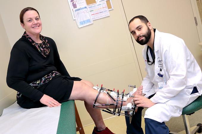 Dr. Michael Assayag treating a patient who has an external fixator on her leg at the International Center for Limb Lengthening