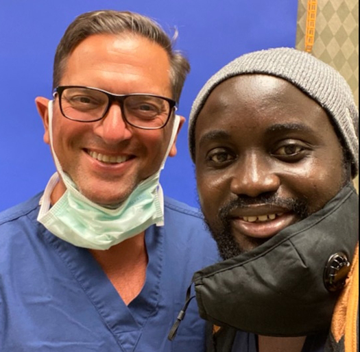 Ebou smiling with Dr. Christopher Bibbo