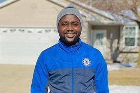 Ebou smiling outside