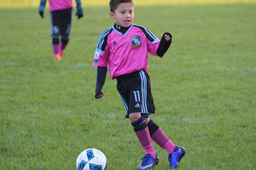 JJ playing soccer after treatment