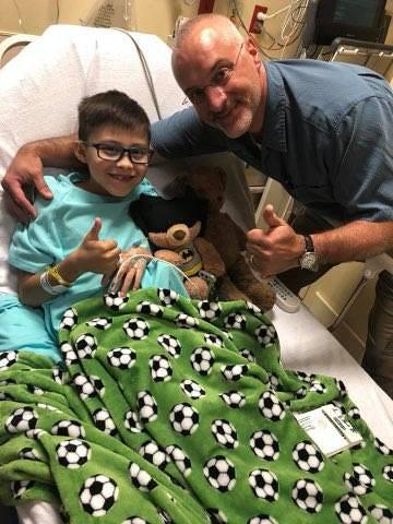 Dr. Standard visiting JJ in a hospital bed