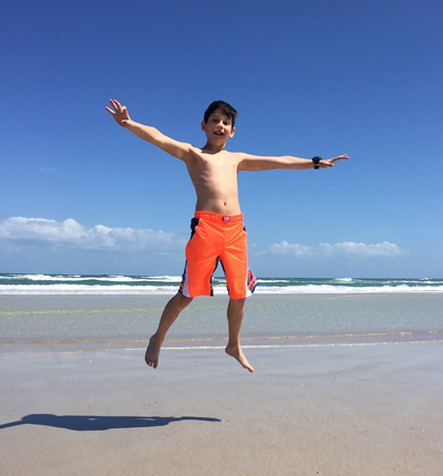 Jackson jumping up high on the beach
