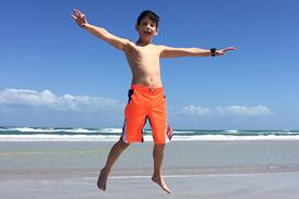 Jackson jumping up high on the beach