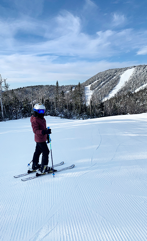 Jadon skiing in the snow on a mountain