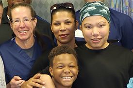 Kahlil in a leg cast with his family, Dr. Conway and some of his Sinai Hospital treatment team