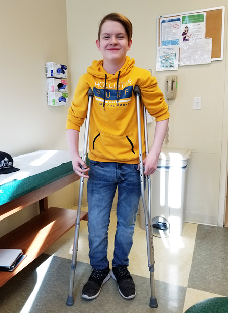 Aaron on crutches after a lengthening