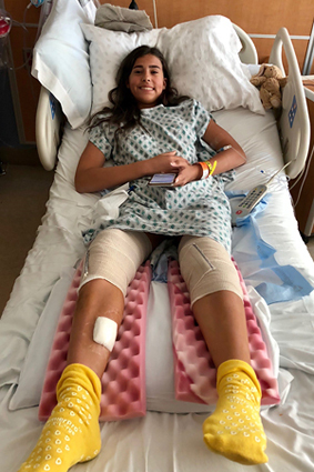 Cassidy as a girl in a hospital bed recuperating after a procedure