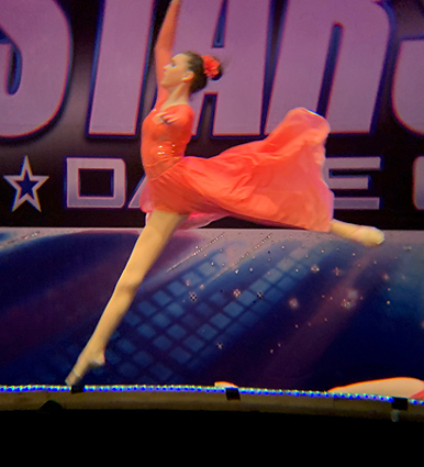 Cassidy as a teenager leaping in her first prize-winning performance at the world dance championships