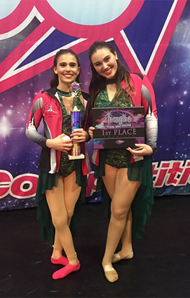 Cassidy as a teenager with her older sister Abby with their first-place award in the Imagine National Dance Challenge