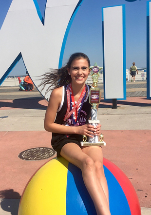 Cassidy as a teenager with her dance championship medals and trophy