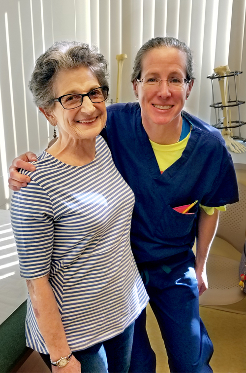 Elaine and Dr. Janet Conway smiling at a clinic follow-up appointment